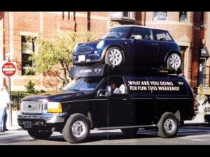 Mini Cooper on an SUV being driven around a city